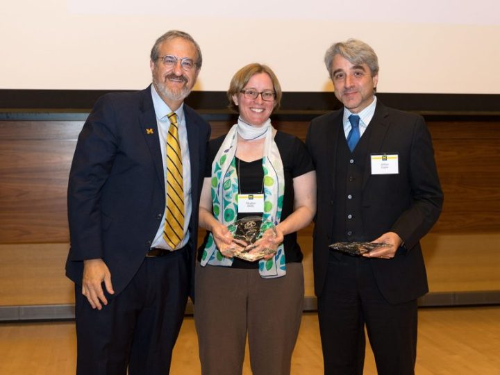 Michigan's President Mark Schlissel on the left, Meghan Duffy in the middle, and Arthur Lupia on the right. Meghan and Arthur are holding glass bowls