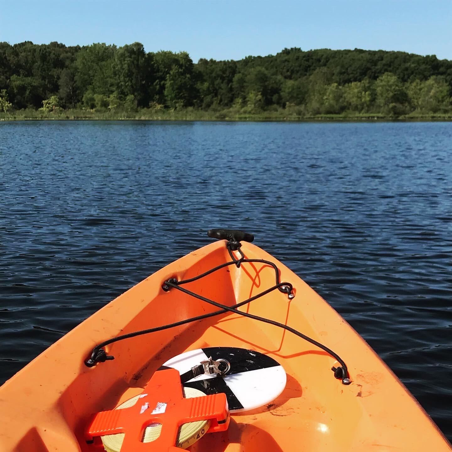 Kayak with a Secchi disk visible on the front